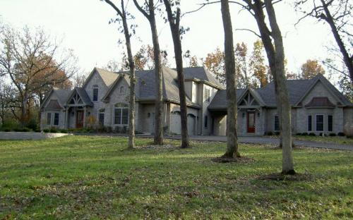 This 9,000 Sq. Ft. Custom home in Bull Valley was built on 5 acres