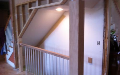 Opening up walls to include the basement as part of the living space, Mchenry IL